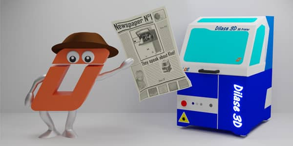 O wearing hat and holding newspaper alongside high resolution 3d printer Dilase 3D